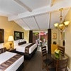 Two Room Suite with 3 Queens & Private Patio